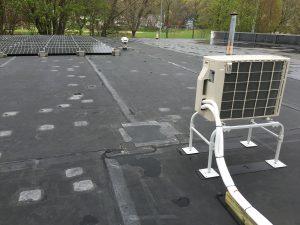 solar panels and mini split HVAC on roof of moving storage warehouse