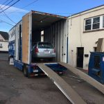 loading up a car for auto transport in our kentucky trailer