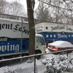 moving company trucks in a snow storm