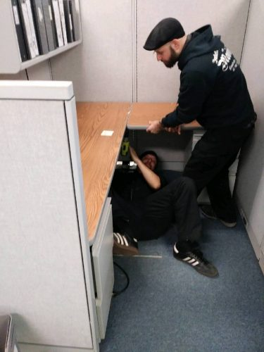vinnie and paul disassembling an office cubicle on an office move in boston